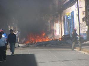 Some barricaded intersections were still burning.