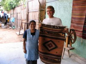 Jesse with he woman who made this rug.