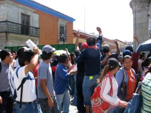 Protesters taunting the federal police who had retaken control of the Zocalo.