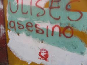 wall graffiti:  The governor is an assaine igne