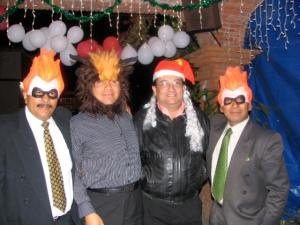 Jose and his brothers at his Christmas Eve party.