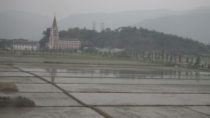 Seen from our train between Xiamen and Shanghai, church in the countryside