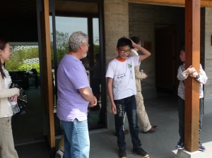Barry talking to kids after a church service near Hangzhou