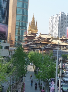 Shanghai Temple--the gold bank building looms over the temple