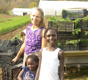 Joanne and Angel in the fields.  Their CSI family spent a few hours working on the farm in exchange for boxes of organic produce!
