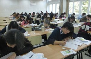 SHNU students taking their final essay exam. Front to back: Max, Chloe, Cici, Melody, Lily, Woody