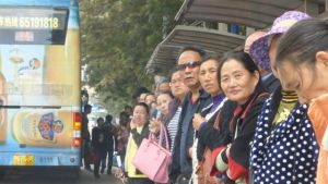 Waiting for a bus in Kunming, Yunnan Province, China