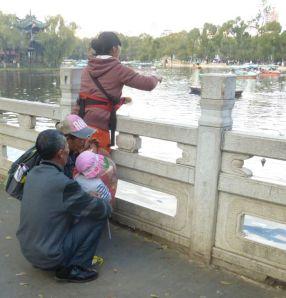 Mom, grandpa, grandma, and child in Kunming, China