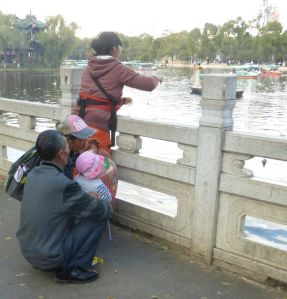 Mom, grandpa, grandma, and child in Kunming, China