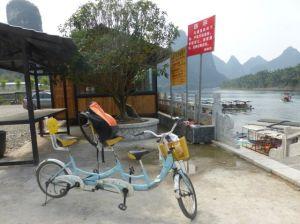 A bicycle made for three.  Mu Shan Village, Yunnan Province, China