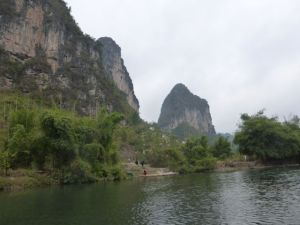 Bikers along the bank of the Yulong River