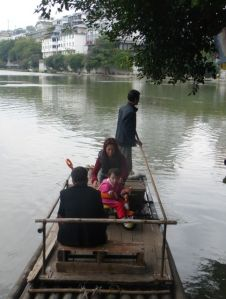 A girl and her parents in Guilin, China