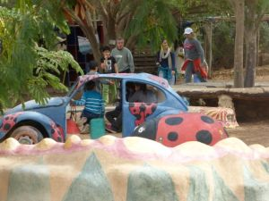 Even after this old VW Bug had been decorated and put in the Eco Kaf playground, someone wanted a part, jacked up the car, got what he needed, and then set the car back down - where it is giving much pleasure to kids today.