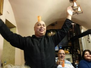 Michael dancing around with a glass of Greek ouzo on his head :)