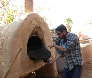 Adam showing us a wood- burning oven.