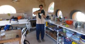 Hilary - from Chicago - a kibbutz volunteer, in the field kitchen (mud dome).