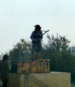 "As in many cities, you will find street performers.  We heard ""Fiddler On the Roof"" several times. :)"
