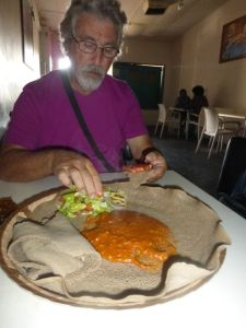 Ethiopian cuisine characteristically consists of vegetable and often very spicy meat dishes, usually in the form of wat (also w'et or wot), a thick stew, served atop injera, a large sourdough flatbread, which is about 20 inches in diameter and made out of fermented teff flour.