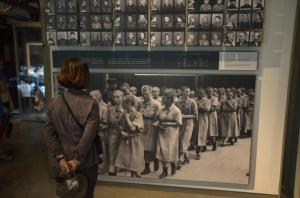 Visitor looks at pictures of Holocaust victims at Yad Vashem in Jerusalem