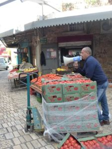 This man was yelling that his tomatoes were so cheap that he must have stolen them. :)