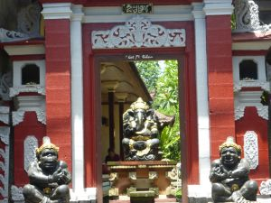 Ganesha, remover of obstacles, is in the middle of this doorway with the guards on either side of the opening