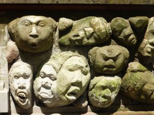 A wall next to Nyomen's where we buy many of our gifts from Ubud; her husband carved these faces just to decorate the wall