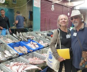 Barry & me - and lots of fish in the Acre market.