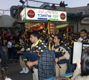 Christian Arab  Scottish bagpipers!!   Who would ever guess this would be part of a Christmas parade in Nazareth!