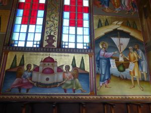 The church has three pink domes.  Here's a painting of it within the church.
