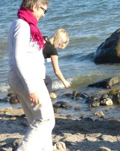 Looking for shells at the Sea of Galilee - Brigitte and Angelica