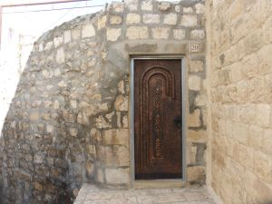 Homes are hidden behind doors and walls within the Old City walls.