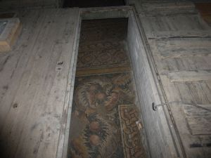 A wooden floor had been built over the original mosaic floor.  Part of the renovation is to restore the floors.
