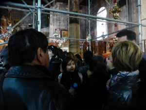 Inside the church was crowded, dark, under reconstruction