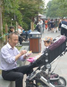 Loving grandfather with his granddaughter in Hongzhou ???  China.  Fifty years ago, would this scene have happened?