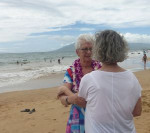 Carol chanting - and presenting Darlene with a lei