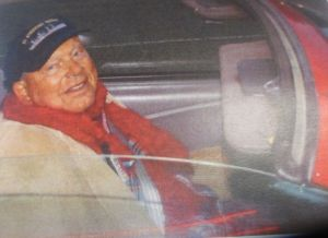 Russ Rosene cruising in his red Mustang convertible