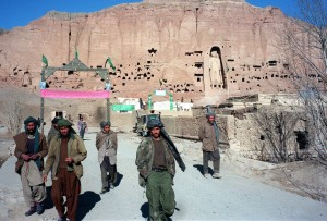 A filer picture dated 07 December 1997 shows soldiers belonging to Shiite faction Hizb-i-Wahdat on patrol in front of a hill with the ancient Bhuddha Statue in Bamiyan province of Afghanistan. Afghan Foreign Minister Wakil Ahmad Mutawakel insisted 08 March 2001 that a decree by the Taliban's supreme leader, Mullah Mohammad Omar, ordering the total destruction of all statues in the country was