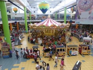 A carousel, a train, and magic acts - all at Albrook Mall