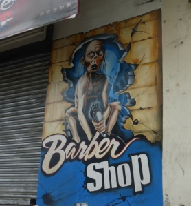 Memorable Panamá City sign - but I hope the stylist doesn't really look like this