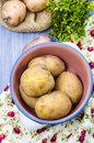 boiled-potatoes-their-skins-raw-parsley-39400568