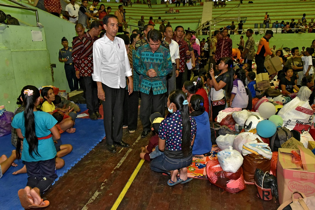 Indonesia President Joko Widodo visits a temporary shelter for people who live near Mount Agung, a volcano on the highest alert level,  in Karangasem